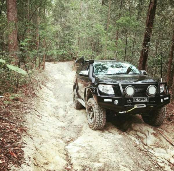 4WD driving up a dirt road